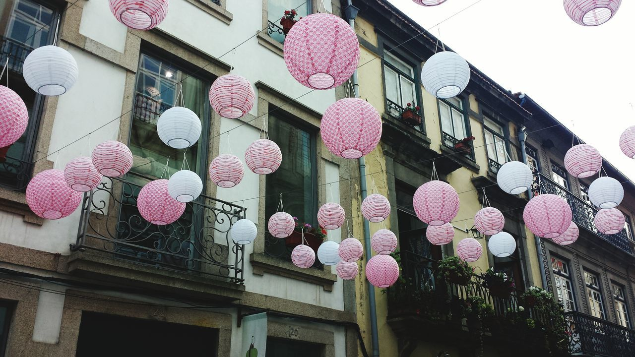 Low Angle View Of Lanterns Hanging Against Building