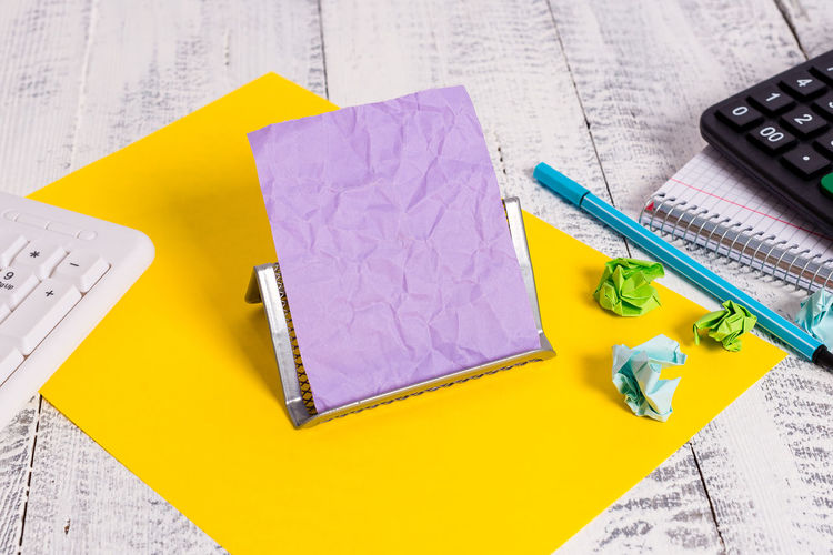 High angle view of pen and paper on table