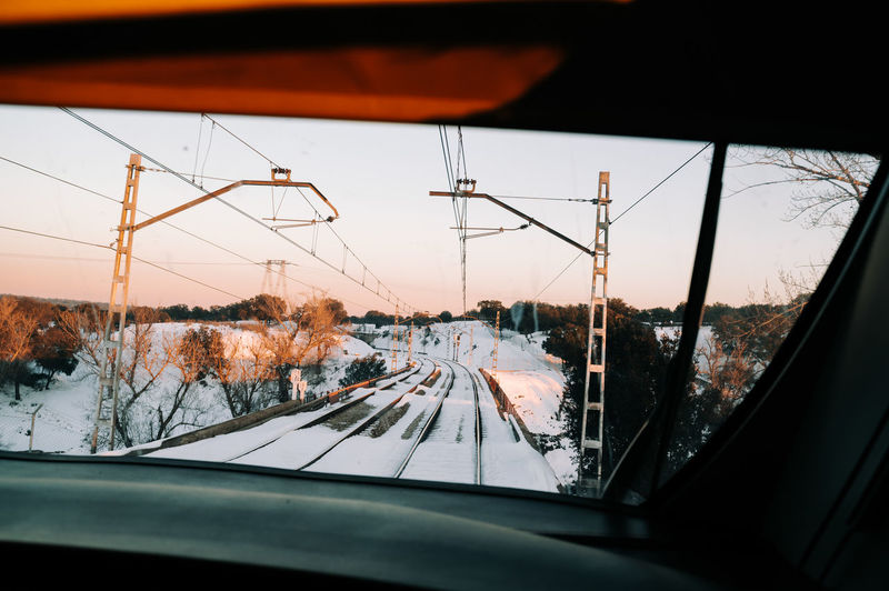 Reflection of sky seen through car window