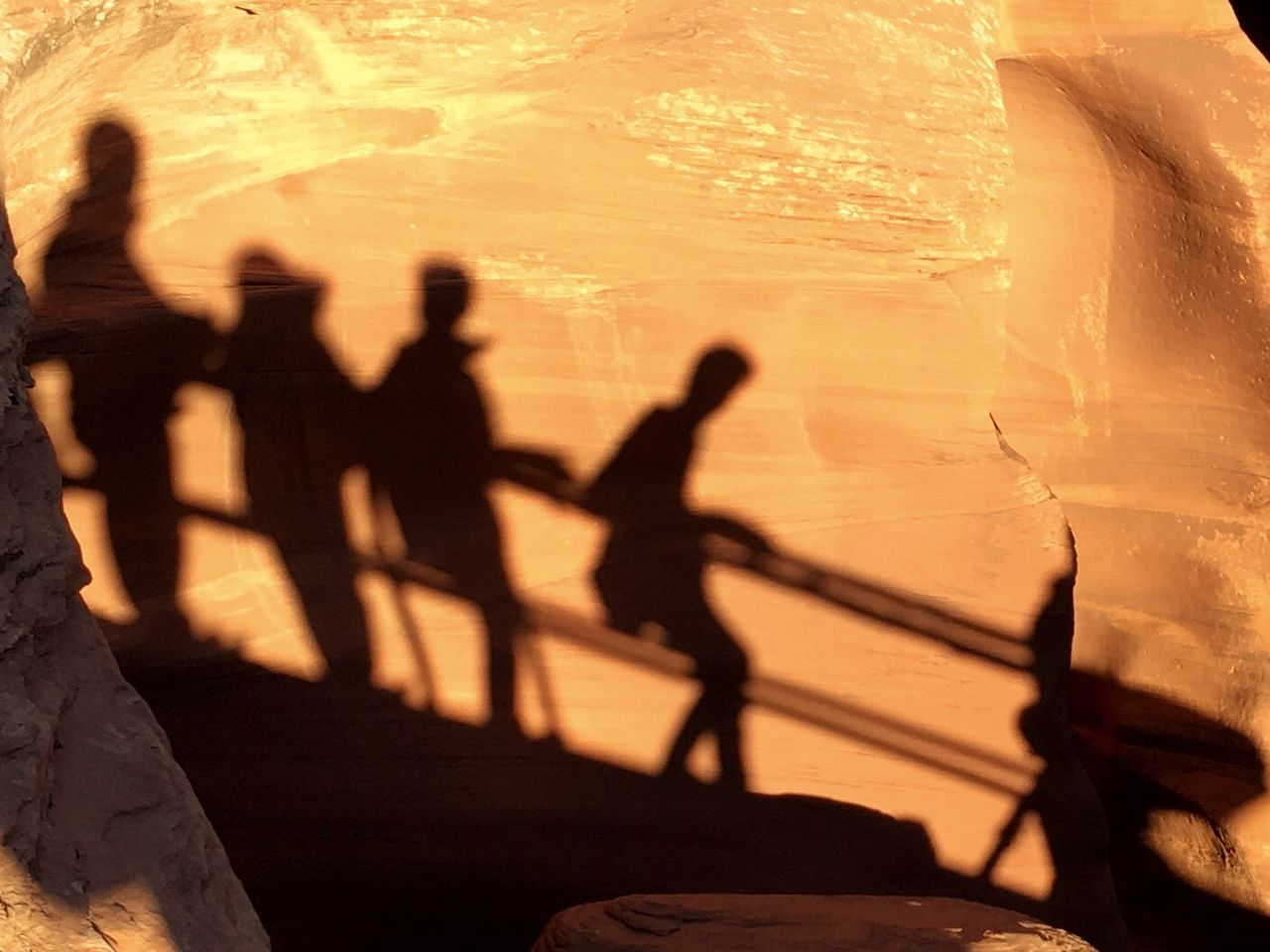 High angle view of silhouette people in sunlight