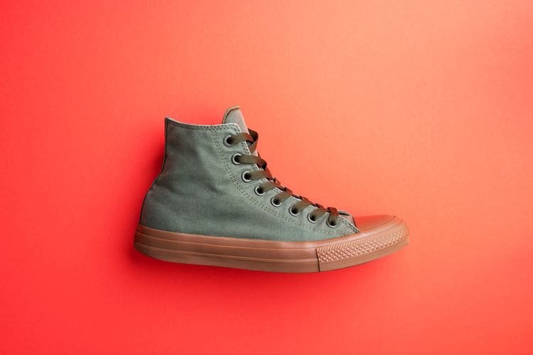 High angle view of shoes on red background