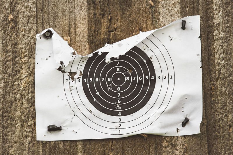 Close-Up Of Bullet Holes On Paper Target