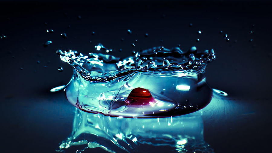 Backgrounds Black Background Blue Blue Sky Drop Focus On Foreground Indoors  No People Red Reflection Shiny Still Life Studio Shot Water Water Droplets