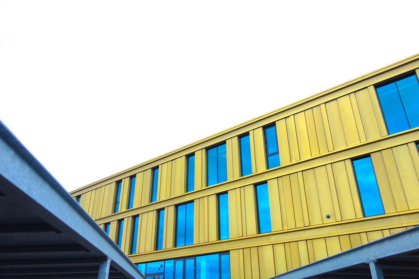Abstract Architecture Architecture Blue Building Building Exterior Clear Sky Copy Space Day Daylight Gold Golden Low Angle View Modern Office Building Sky