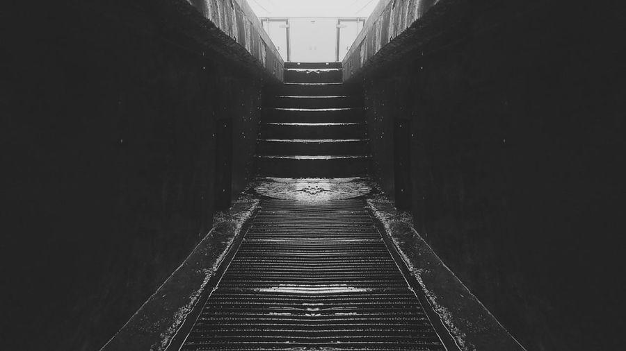 Narrow walkway along empty road