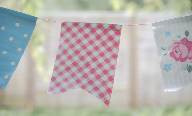 Celebratory bunting. Celebration Bunting Bunting Flags Close-up Clothesline Day Emotion Flags Flags In The Wind  Focus On Foreground Hanging Nature No People Outdoors Pattern Plant Selective Focus Table Textile