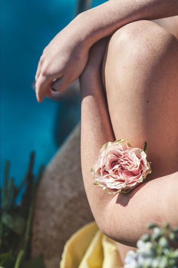 Human Body Part One Person Body Part Women Adult Nature Midsection Young Adult Close-up Land Flower Focus On Foreground Lifestyles Flowering Plant Relaxation Human Limb Water Outdoors Day Beach