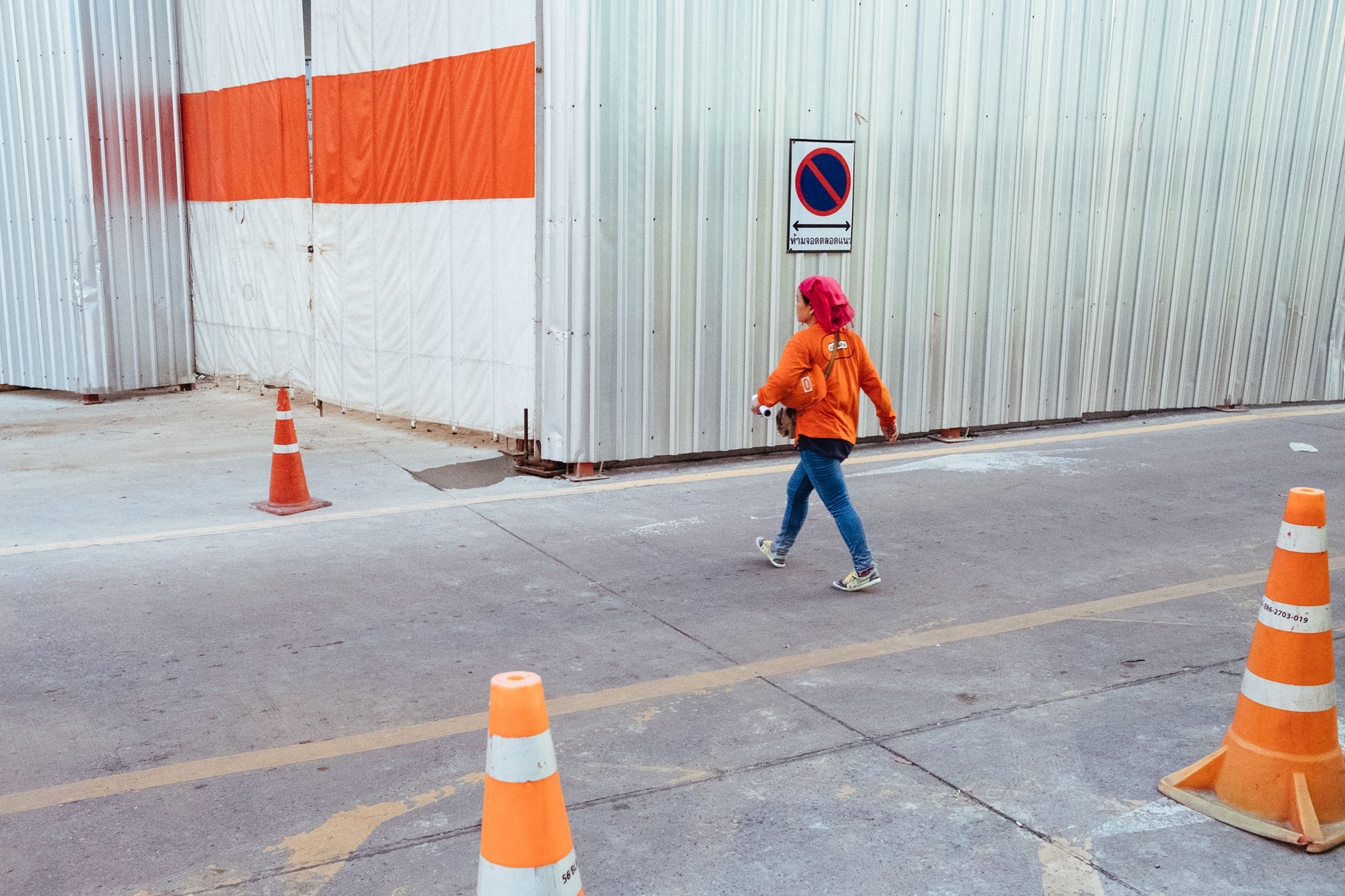 striped, outdoors, full length, asphalt, children only, road, day, real people, one person, flag, people, protective workwear