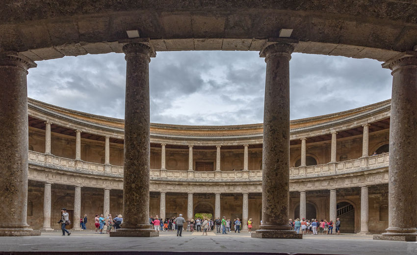 GRANADA, SPAIN - October 11, 2018: The famous Alhambra in Granada, Spain. It is a palace and fortress complex located in Granada. Granada SPAIN Alhambra Alhambra De Granada  Architecture Arabic Style Ancient Architecture Mosque Architecture Interior Design Architectural Column History Group Of People Large Group Of People The Past Crowd Built Structure Cloud - Sky Tourism Travel Destinations Building Exterior Travel Outdoors Ancient Civilization Colonnade