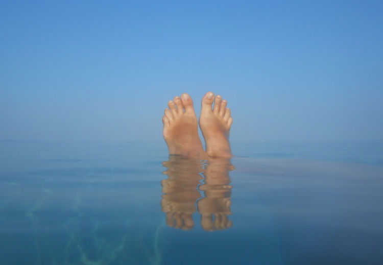 Feet up in the sea Reflection Sea Water Nature Real People Sky Swimming Relaxation Holiday Blue Chilling Out Travel Feet Up Tourism Vacation Waterfront Lifestyles Body Part One Person Human Foot Leisure Activity Horizon Over Water Human Leg Human Body Part barefoot Women Day Outdoors Swimming Pool Finger Human Limb Low Section
