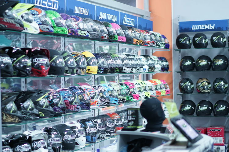 Bike Choice Choosing Customer  Day Head Protection Helmet Helmets Icon Moto Motorsport One Person Outdoors People Protection Retail  Ride Shelf Store Variation