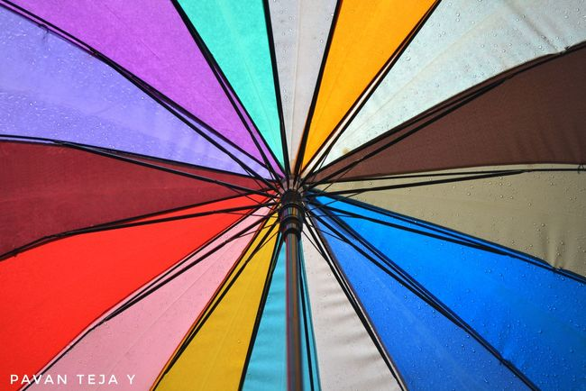 Learn & Shoot: Balancing Elements Umbrella Colors Color Revolution Day Outdoors Pattern Close-up Hyderabad Epic Shot Photography Leisure Activity No People Eyemphotography Dslrphotography Photography In Motion Rain RainyDay Rainy Season Blue Orange Red Yellow Yellow Color
