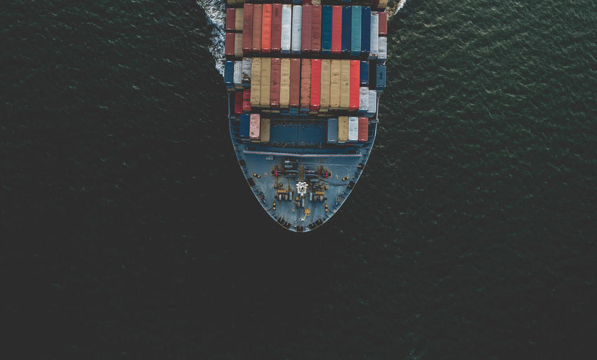 Directly Above Shot Of Cargo Containers In Ship Sailing On Sea