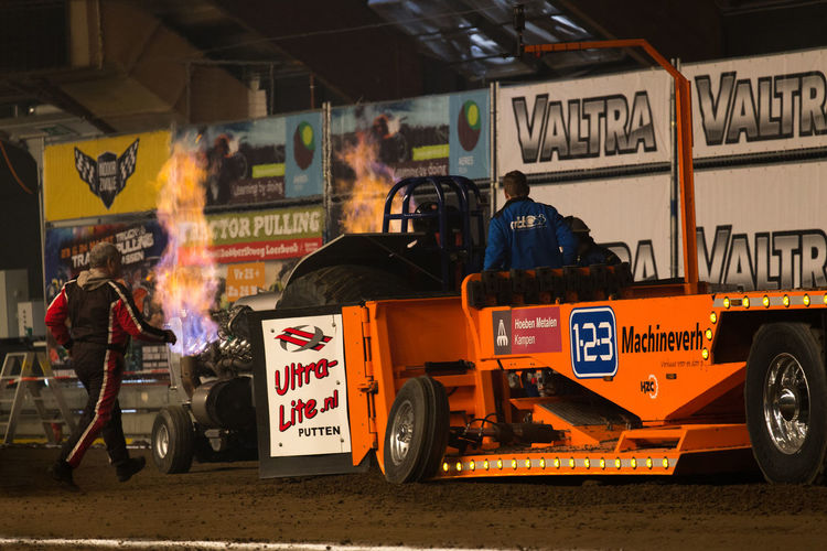 Jet Engine Supercharged  Tractor Tractor Pulling V-8 Architecture Building Exterior Built Structure City Day Horsepower Land Vehicle Loud Men Mode Of Transport Occupation Outdoors People Pull Real People Road Text Tractor Pull Transportation Turbo Wheelie Women