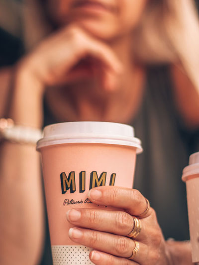 Adult Close-up Coffee Coffee - Drink Coffee Cup Cup Drink Finger Focus On Foreground Food And Drink Hand Holding Hot Drink Human Body Part Human Hand Lifestyles Mug People Portrait Refreshment Text Women