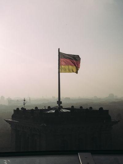 Flag flags against clear sky