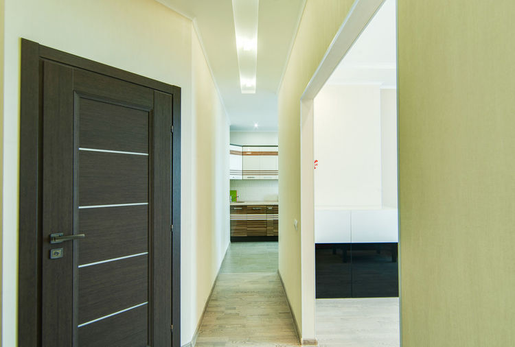 Door Architecture Building Entrance Indoors  Corridor Arcade No People Built Structure Flooring Empty Absence Day The Way Forward Illuminated Lighting Equipment Direction Modern Office Ceiling