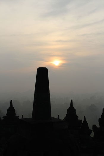 Silhouette Borobudur Temple with the mysteries forest surrounding during sunrise, Yogyakarta, Indonesia Ancient Borobudur Temple Java Yogyakarta Ancient Civilization Architecture Belief Buddhism Built Structure Cloud - Sky Dawn Fog Forest History Mount Merapi Nature No People Place Of Worship Religion Religious Architecture Silhouette Sky Spirituality Sunrise Sunset