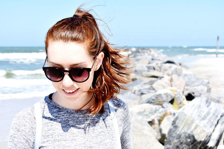 Woman wearing sunglasses at beach