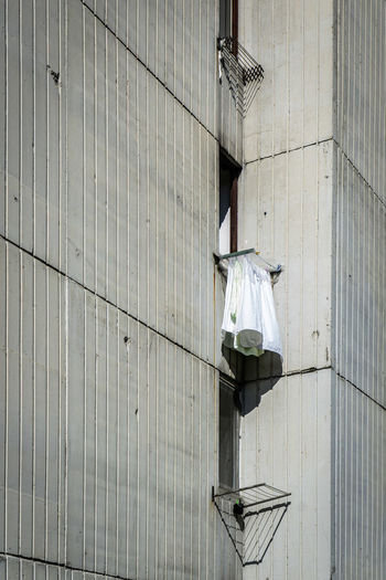 Low angle view of clothes hanging on building