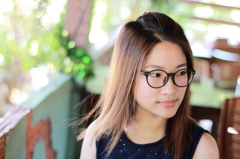 EyeEm Selects Eyeglasses  Smiling Long Hair Happiness Relaxing Freshness Pretty Headshot Young Women Indoors  Day Beautiful Woman Fashion Cute Asian  Girl Portrait