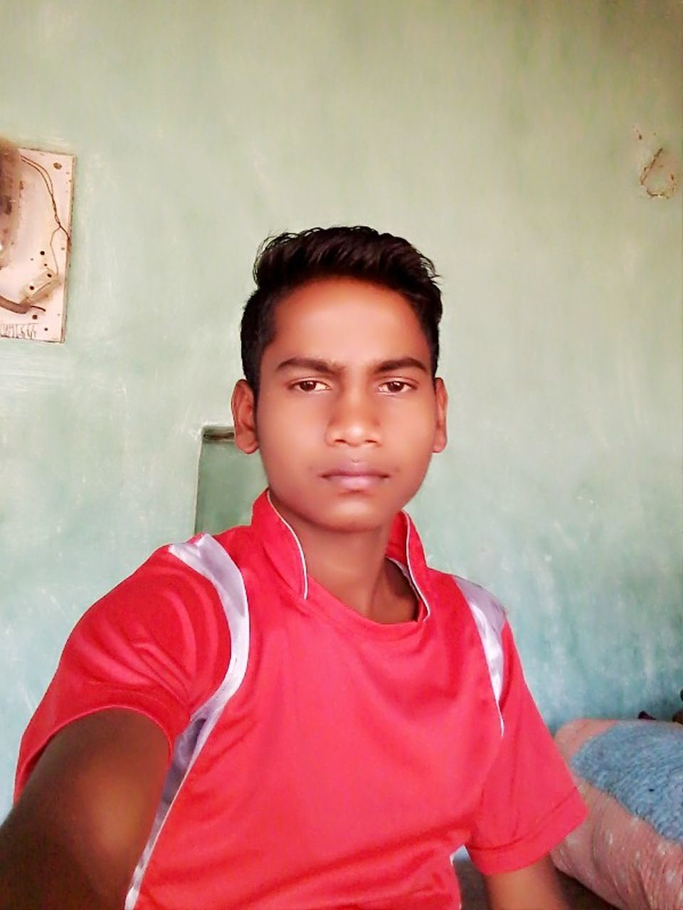 one person, real people, casual clothing, looking at camera, leisure activity, childhood, portrait, front view, teenager, lifestyles, boys, day, indoors, one teenage boy only, close-up, people