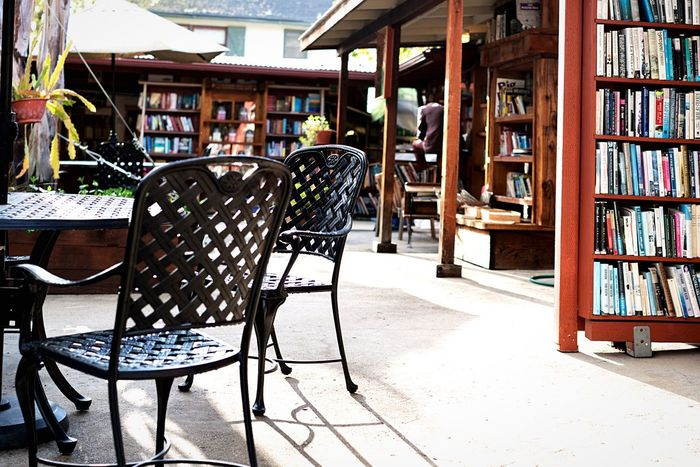 It's Outside . It's Inside . It's a Bookstore . It's all three! What's more, the books were dry despite the rains that day! Used Bookstore Patio Furniture Patio Chairs Interior Views At The Used Bookstore Hidden Gems