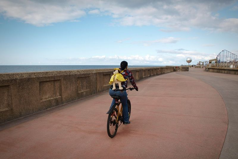 Blackpool Bicycle Ride Cycling Sea Seaside Sea Front Promenade Transportation One Person Rear View Sky Outdoors Leisure Activity Fairground Adventure Sea View Water Rollercoaster Travel