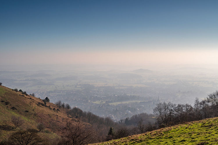 A view of Malvern from the Malvern Hills in South West England. Scenics - Nature Environment Landscape Sky Beauty In Nature Tranquil Scene Tranquility Tree Mountain Nature Plant Non-urban Scene Fog Land No People Day Idyllic Outdoors Copy Space Rolling Landscape Malvern Hills Malvern British Countryside British Hills Worcestershire