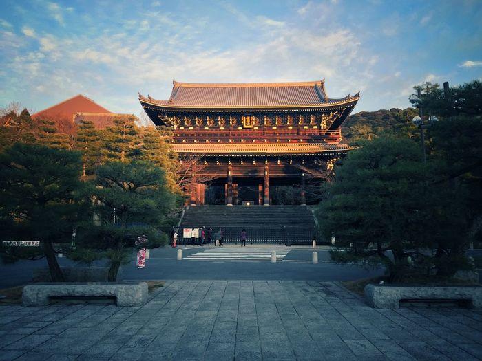 Temple amidst trees against sky