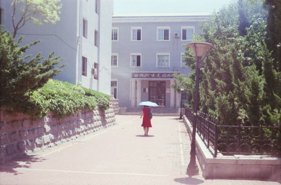 Analogue Photography Architecture Blue Building Building Exterior China Day Dufe One Person One Woman Only One Young Woman Only Rear View Sun Umbrella Tree University Campus Walking Women Young Women