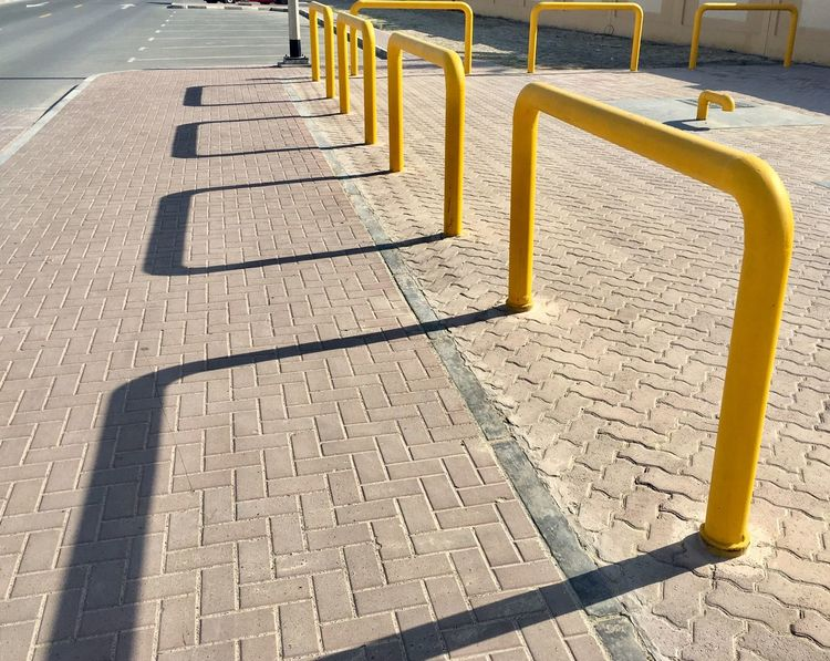 Side by side. Chadventurestories Sunlight Shadow No People Outdoors Day Shadows & Lights Shadowplay Yellow Summer Geometry Shapes Lot Space EyeEm Selects EyeEmNewHere Street Culture Photography Bricks Walkway Pattern Design Natural