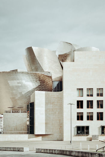 Guggenheim museum Guggenheim Apartment Architecture Building Building Exterior Built Structure City Cloud - Sky Day Factory Guggenheim Bilbao Guggenheimmuseum Low Angle View Modern Musee Museum Nature No People Office Outdoors Residential District Sky Sunlight Travel Destinations Window