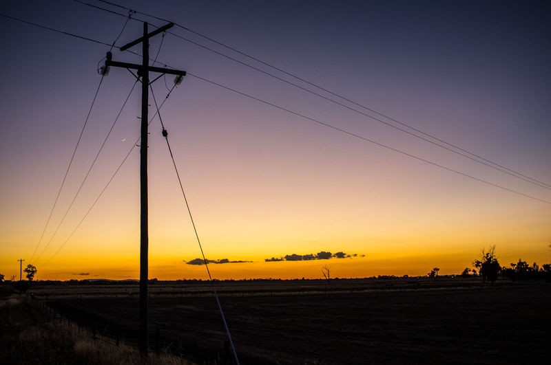 Sunrise in the country Beautiful Sky Cloud - Sky Country Sunrise Electricity Pylon Environmental Conservation Golden Sky Landscape In The Country Leading Lines Light Low Angle View Outdoors Power Line  Silhouette Sky Sunrise In The Country X100