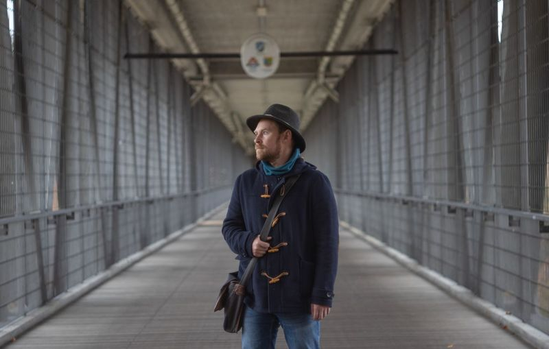 Full length of man standing on bridge