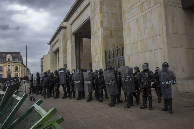 Police Force With Shields On Street