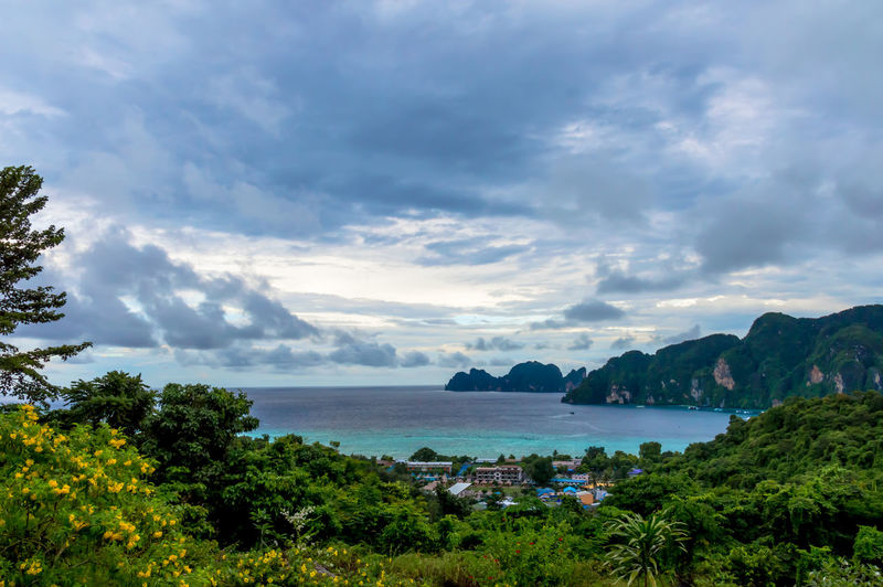 Scenic view of mountains by sea against cloudy sky at ko phi phi le island