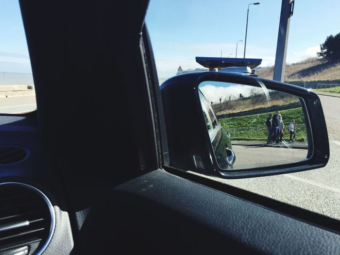 Cropped image of car on road