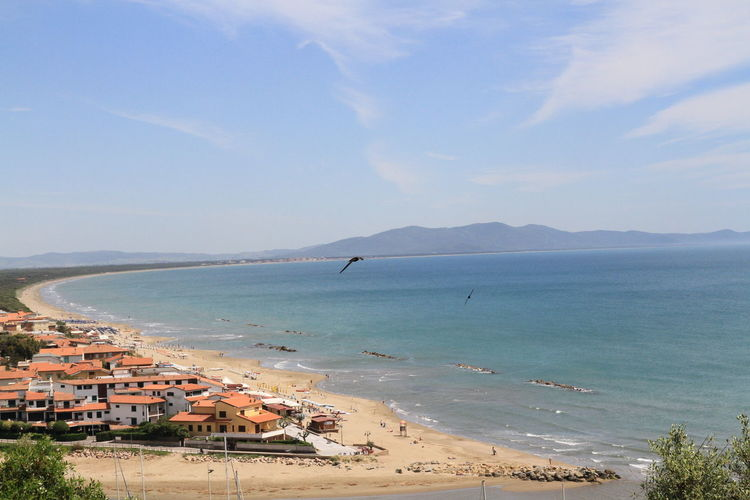 Grosseto sea Grosseto Sea Beach Sand Water Horizon Over Water High Angle View Outdoors Day Landscape No People Building Exterior Nature Architecture Scenics Mountain Sky Blue Beauty In Nature Built Structure Swimming