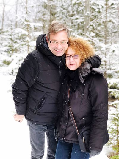 Portrait Of Couple Standing Against Trees During Winter