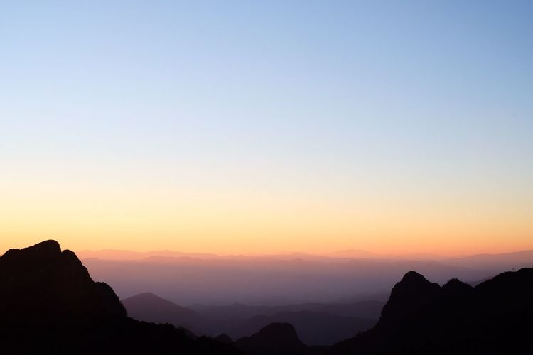Sky Beauty In Nature Sunset Silhouette Scenics - Nature Tranquil Scene Tranquility Mountain Copy Space Nature Orange Color Mountain Range No People Environment Rock Landscape Outdoors