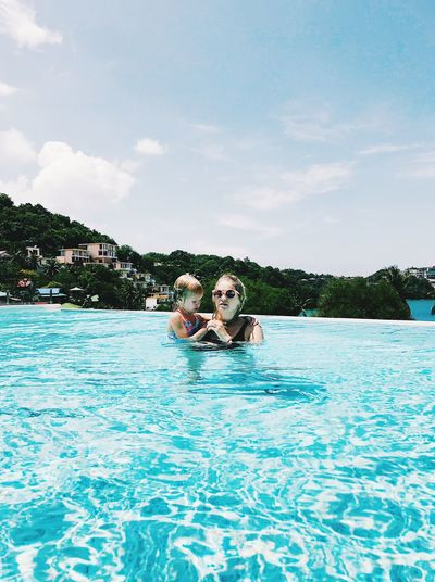 Portrait Of Woman With Daughter Swimming In Pool