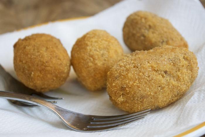 rice balls or arancine Appetiser Appetizer Arancine Arancini Croquettes Fried Frying Rice Balls