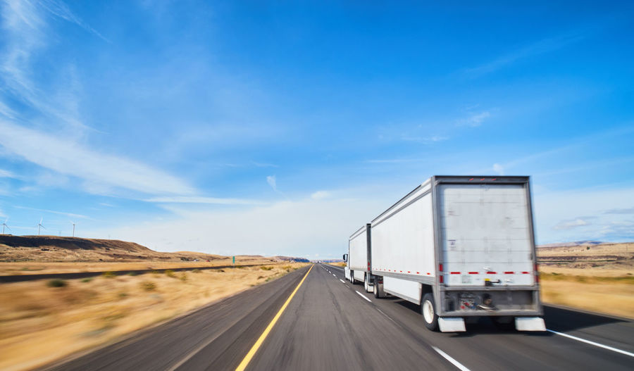 Transportation Road Sky Land Vehicle Truck Mode Of Transportation Motion Nature Direction Freight Transportation Motor Vehicle Outdoors Highway Cloud - Sky Day Semi-truck Driving on the move Travel The Way Forward Trucking Multiple Lane Highway