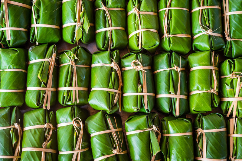 Full frame shot of food wrapped in banana leaves for sale at market stall