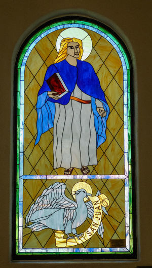 San Lorenzo, Catholic Church, Clint Texas. Saint Lorenzo is the Patron Saint of Cooks Representation Human Representation Art And Craft Window No People Creativity Male Likeness Female Likeness Architecture Stained Glass Building Built Structure Religion Glass - Material Spirituality Place Of Worship Belief Glass Angel Mural