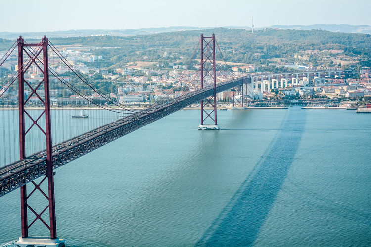 A major 25th of April bridge in Lisbon, built exactly the same as Golden Gate Bridge in San Francisco Same  25th April Architecture As Bridge Bridge - Man Made Structure Built Structure California Connection Distant Engineering Golden Gate Bridge Lisbon Long Outdoors Perspective River River, SUPPORT Twin Water