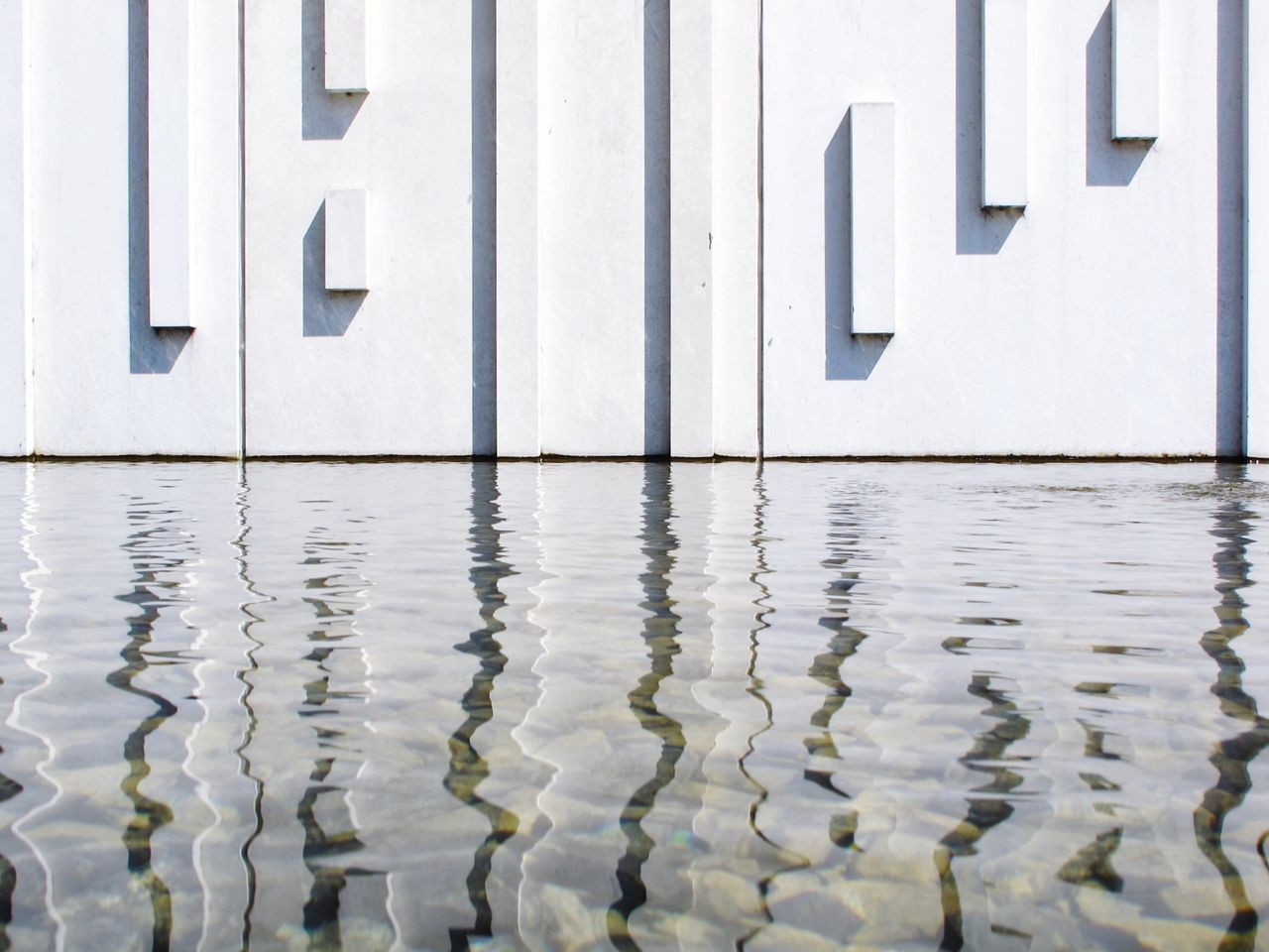Reflection of text on water