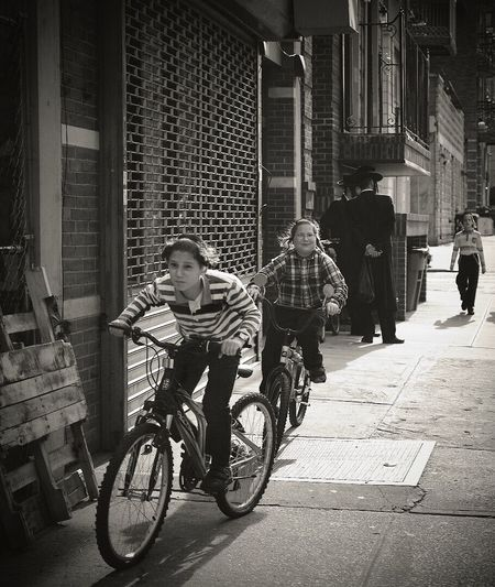 Man with bicycle walking in city