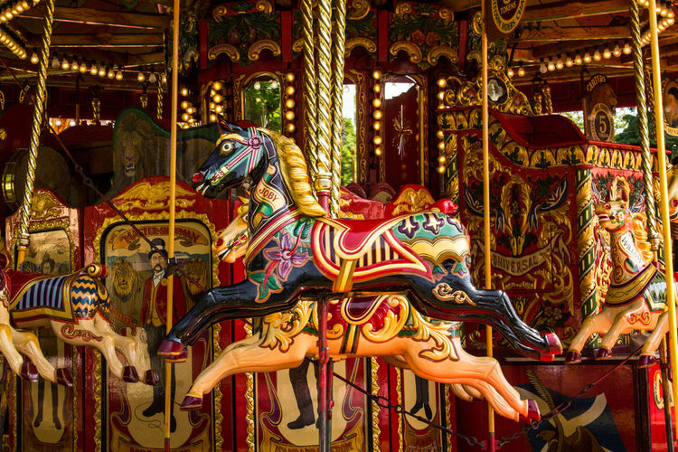 Amusement Park Arts Culture And Entertainment Amusement Park Ride Carousel Carousel Horses Animal Representation Ornate No People Multi Colored Close-up Outdoors Day Vintage Red Funfair Funfair Streetphotography Rides Merry-go-round Fun